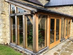 Oak framed lean-to extension by Shires Oak Buildings to garden room