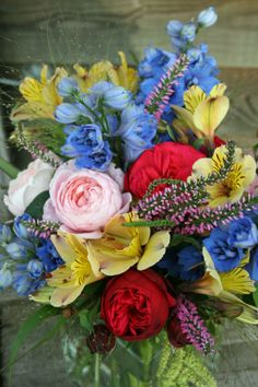 Blue, yellow and red bouquet by Green and Gorgeous