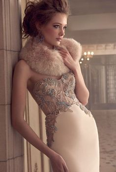 the lace embellished top of this dress is beautiful