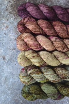 Lock spun white Teeswater wool with multi colored longwool locks added. Hand spun wool art yarn