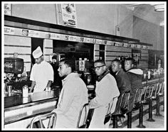 Four black university students from N.C. A&T University began a sit-in at a segregated F.W. Woolworth's lunch counter in Greensboro, N.C. Although they were refused service, they were allowed to stay at the counter. The event triggered similar nonviolent protests throughout the South. Six months later, the original four protesters are served lunch at the same Woolworth's counter. Student sit-ins would be an effective tactic throughout the South in integrating parks, swimming pools, theaters…