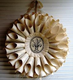 Recycled Paper Wreath... @Katie Johnston I have decided that one day I need to come out there, and we can make lots of stuff... and based on your success with book wreath, I would want help with this!