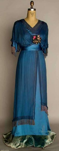 SILK EDWARDIAN EVENING GOWN, c. Powder blue silk satin with blue chiffon overdress, ribbon rosette trim, trained skirt with velvet hem band, - Edwardian Fashion Edwardian Gowns, Edwardian Clothing, Antique Clothing, Edwardian Fashion, Edwardian Style, Vintage Fashion, Gothic Fashion, Historical Clothing, Silk Evening Gown
