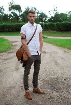 The versatility of a brown leather bomber jacket and charcoal jeans makes them investment-worthy pieces. Turn your sartorial beast mode on and make brown leather derby shoes your footwear choice.   Shop this look on Lookastic: https://lookastic.com/men/looks/bomber-jacket-short-sleeve-shirt-jeans-derby-shoes-messenger-bag-watch/11792   — White Short Sleeve Shirt  — Gold Watch  — Brown Leather Messenger Bag  — Brown Leather Bomber Jacket  — Charcoal Jeans  — Brown Leather Derby Shoes