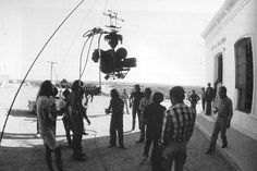 "Filming of the penultimate shot in ""The Passenger"" (1975), a seven minute, indoor/outdoor, rotating tracking shot (filmed before the fully portable steadicam was devised)."