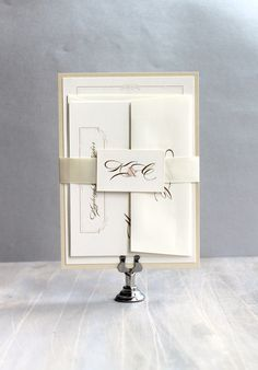 Elegant Ivory - elegant gold wedding invitations with touches of ivory, champagne and gold perfect for any modern day elegant event. Simple, yet
