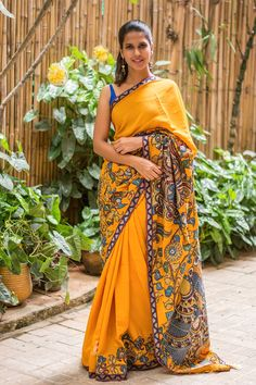 Bringing you another stellar Kalamkari detailed drape to expand your choices! This time in a pure crepe. A warm and happy orange saree with handpainted birds, flowers and vines images in Kalamkari appliqued into the border ending with luxurious pallu detailed with a Kalamkari exotic bird motif and a slim brocade edged all arounds. Be the stand out girl in all your dos in this special number. #kalamkari #crepe #mustardishorange #applique #saree #India #blouse #houseofblouse