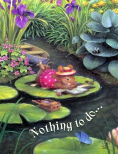 This little mouse is resting on a lily pad as comfy as can be enjoying  a good book and enjoying the day