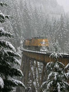 Union Pacific Railroad Freight Train crossing a snow covered train trussel. Train Tracks, Train Rides, Locomotive, Tramway, Union Pacific Railroad, Union Pacific Train, Bonde, Train Pictures, Winter Scenery