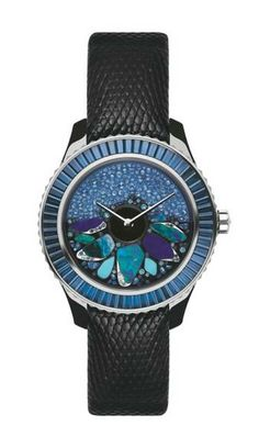 """The Dior VIII Grand Bal is extraordinary and like an haute couture ball gown, it shows design daring and technical prowess. The rotor on the dial is lavishly decorated with the improbable combination of opals, lapis lazuli, turquoise, chrysocolla, sapphires and Paraiba tourmalines that work unexpectedly well together."""