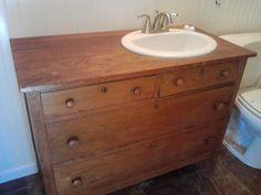 Old dresser turned into bathroom vanity.