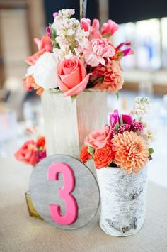 #table-numbers, #centerpiece  Photography: Paper Antler - paperantler.com Floral Design: Sweet Pea Flowers - sweetpea-flowers.com  Read More: http://www.stylemepretty.com/2013/01/30/vail-colorado-wedding-from-sweet-pea-flowers/
