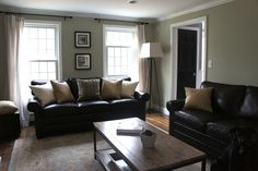 I like this wall color with the black leather furniture, and also the curtain idea for our living room.