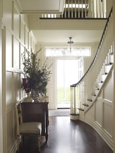lots of wainscoting in the foyer - great idea.  Suzanne Rheinstein.