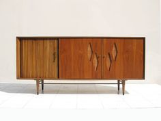 Furnette Walnut Credenza with Tambour Doors $1800    I passed on this at a vintage show and am now SICK about it. Please, please let me know if you see it or one like it