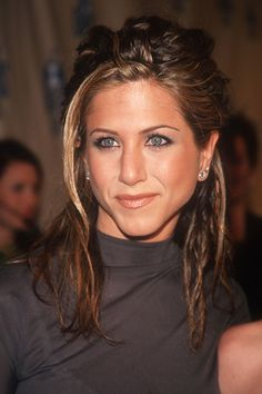 a dreadlocked Jennifer Aniston circa 1997 (reminiscent of her Counting Crows bf a few years earlier)