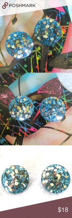 """Vintage Huge Blue Glitter Silver Confetti Earrings Vintage Blue Confetti Glitter Oversized Earrings Super fun, huge clip on earrings made of lucite plastic most likely filled with blue glitter and silver confetti. Measures 1.5"""" in diameter Condition: Good vintage. There is a ding on the side of one earring which is not visible, can just be felt by running your finger over it. Vintage Jewelry Earrings"""