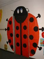 Creating a ladybug classroom door decoration is a fun idea for spring.  I would write the names of my students in the black circles or glue pictures of them inside each circle.