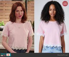 Kimmy's pink top with flower trim on Unbreakable Kimmy Schmidt. Outfit Details: http://wornontv.net/46729/ #UnbreakableKimmySchmidt
