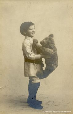 Teddy Bear with his original owner 1908. Original vintage photograph. You can tell this bear was well loved by this boy <3    http://www.myteddybearmuseum.com/bears/Teddy%2520Boy%2520and%2520child%2520large.jpg