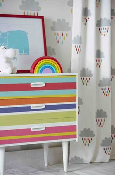 Get your wellys at the ready with our 'April Showers' fabric and wallpaper! The beautiful appliqué and embroidery design makes everyone want to play in the puddles and what's more, it has a matching wallpaper! We love this bright primary palette, it's perfect for use in a nursery!