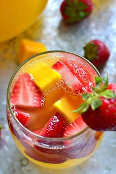 This Strawberry Mango Sangria combines so many summer favorites in one delicious drink! Perfect for parties, ladies' nights, or lazy summer weekends, this sangria is destined to become your new go-to drink! Mango Sangria, Blackberry Sangria, White Sangria, Red Sangria Recipes, Cocktail Recipes, Cocktails, Drink Recipes, Cocktail Drinks, Refreshing Drinks