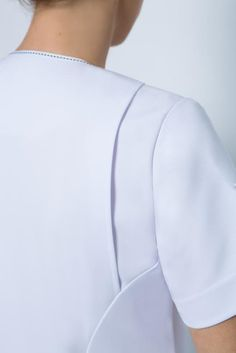 SPA 19 tunic- Action back. Tunic Zip front tunic with two front pockets, short… Dart Manipulation, Spa Uniform, Bike Fashion, Spring Spa, Gown Pattern, Uniform Design, Medical Scrubs, Bike Style, Minimal Fashion