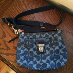 Coach Denim Crossbody Purse Cute purse in great condition, only flaw is the small spot on the strap pictures in #4 but I think it would be really easy to get out. Strap length can be adjusted. Silver hard wear. No marks on the inside, only used a handful of times. Feel free to ask questions! Coach Bags Crossbody Bags