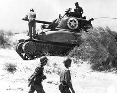 A US crew checks their Sherman tank after landing at Red Beach 2, Sicily on 10 July.