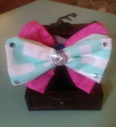 Check out this item in my Etsy shop https://www.etsy.com/listing/226732436/pinkwhite-and-teal-double-bow-tie-with
