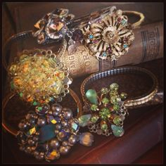 Repurposed watch band and brooch bracelets. Next Project: use vintage watch band purchased from estate sale today plus pieces of vintage costume jewelry