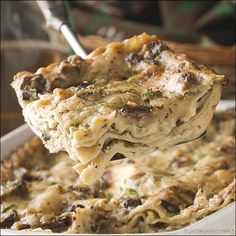 Mushroom Lasagna. No ricotta. No tomato sauce. No meat. Just baby bella mushrooms. Some white wine. Creamy white sauce. A little spinach tucked into the layers. Lots of Parmesan cheese. And, no kidding - this is my new favourite way to do lasagna. Elegant and delicious.