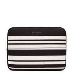 kate spade laptop case...as much as i love pink i never tire of black and white stripes.  it looks so cute with pink, green, yellow and red office accessories and stand outs when the professional work look gets a little boring.