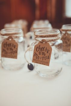 Rustic wedding favor idea - mason jar wedding favors with kraft paper tags with modern calligraphy {Elisavet Photography}