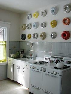 Bundt pans for kitchen wall decor.