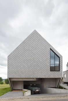 Fibre-cement tiles create a latticed facade for Leeuw House by NU architectuuratelier