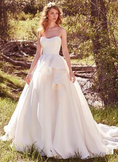 Nikki's Glitz and Glam Bridal Boutique is your one stop shop for all your bridal needs! See all the bridal styles at our website at www.nikkisglitzandglamboutique.com