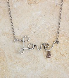 Simply whimsical, this necklace says it all.  The necklace can be ordered as is or add a little love with a bronze or sterling heart.  Or you can create your own version by adding the birthstones or initial of your significant other, children or grandchildren.