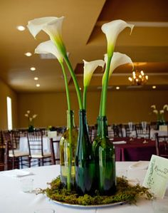 Honey Buy: Color of wedding-green - With glass vases instead of wine bottles and no green stuff on the bottom.