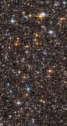 This view across 24,000 light years of the Milky Way Galaxy was taken by Hubble to assess the various ages, in the billions of years, of the galaxy's various stars. Of interest is the small dots that appear between the larger, brighter stars of the Milky Way -- those are numerous distant galaxies beyond our own. (NASA, ESA, and L. Bedin, STScI)