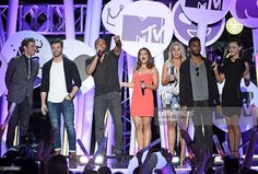 Actors Joseph Morgan, Daniel Gillies and Charles Michael Davis, actresses Danielle Campbell and Leah Pipes, actor Yusuf Gatewood and actress Phoebe Tonkin from 'The Originals' introduce a performance by All Time Low during the MTV Fandom Fest San Diego Comic-Con at PETCO Park on July 9, 2015 in San Diego, California.