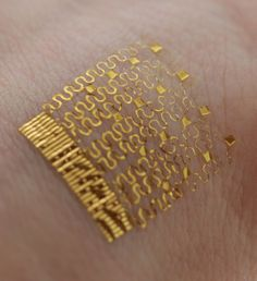 From the University of Illinois - This electronic tattoo contains a hypersensitive thermometer that tracks heat running through a person's veins over  a long period of time. It can measure down to a millikelvin (about two one-thousandths of a degree fehrenheit). This device will help tell the state of a person's overall cardiovascular health.