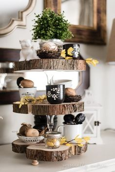 How to make a rustic three tier stand with reclaimed wood slices and glass candlesticks. | personallyandrea.com
