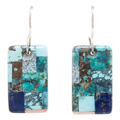 Navajo Native American Turquoise and Lapis Earrings by Brian Tom. This is a pair of Navajo Native American handcrafted earrings by Brian Tom. These earrings are created with Turquoise, Lapis and Pink Mussel Shell set atop Mother of Pearl. Both settings are signed by Brian noted as BT. The earrings are approximately 1 3/4 inches long as measured from the center of the french ear loop to the bottom of the setting and are approximately 5/8 inch wide at the widest point. Total weight of the…