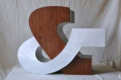 Oh good god, it's an ampersand chair. Amazing.  -- Designed by Tom O' Callaghan & Doug Turner, engineered and fabricated by Doug Turner & Stephen Evans.