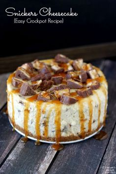 Homemade Snickers Cheesecake made in the crockpot! You will want to try this Crockpot dessert Recipe!