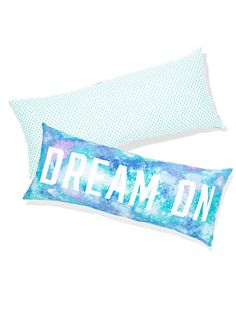 This could be an easy DIY pillow..  Use letters as stencils and splatter or airbrush your fave colors, let dry and then remove the stencil