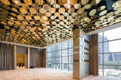14-metre decorative ceiling made of golden reflective discs weighing 3000 kg. The effect is enhanced by crystal stalactites randomly dripping down between the discs.