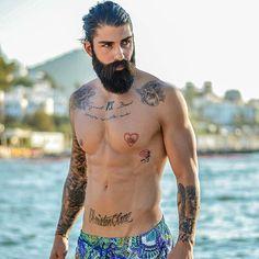 """Swim trunks on point✌️ This is @welovekaani photographed by @ozsugraphy #SebastianBeachClub #BeardAndTats"""