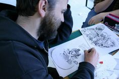 Nicholas Rawling - crafting each character and scene element with pen and paper.